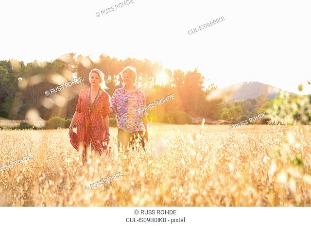 Young couple standing in wheat field, Majorca, Spain