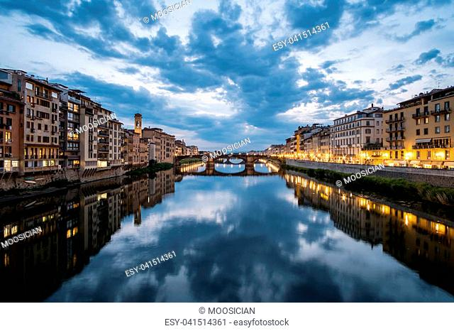 View of the Bridge and Building along Arno river in Florence, Italy. At night