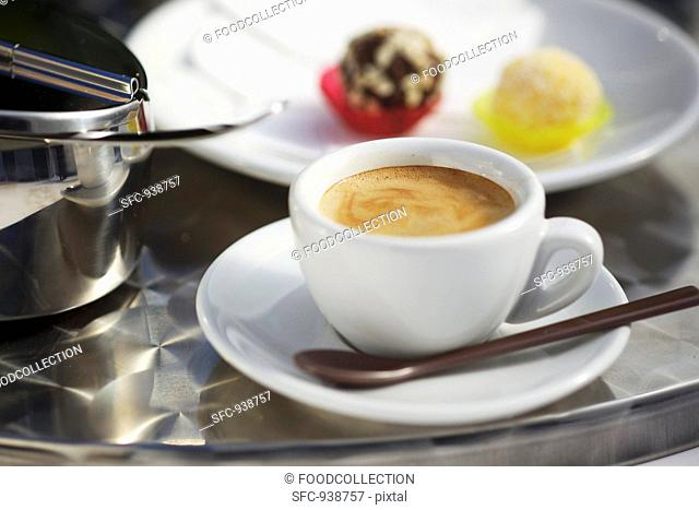 Espresso, a sugar tin and Italian sweets