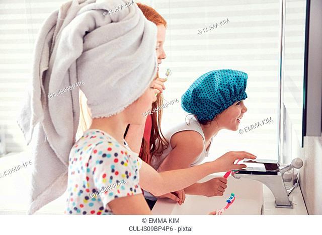 Girls brushing teeth