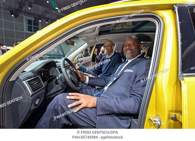 Former LA Lakers basketball players Kareem Abdul-Jabbar (l) and James Worthy sitting in a VW Atlas at the Los Angeles Auto Show in Los Angeles, US