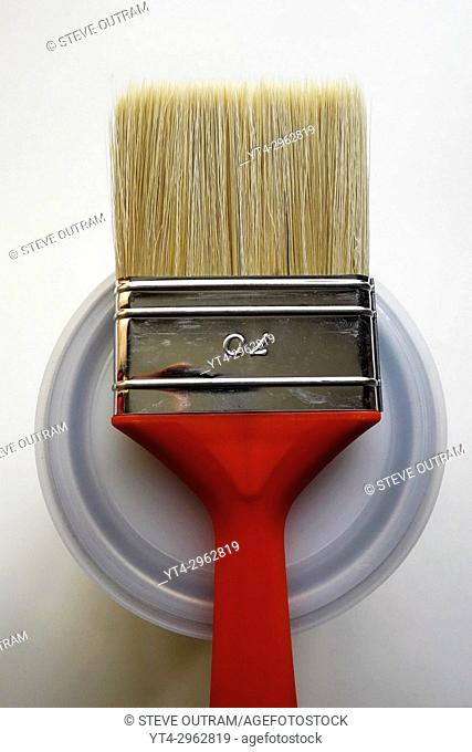 Red Paint Brush on top of Can