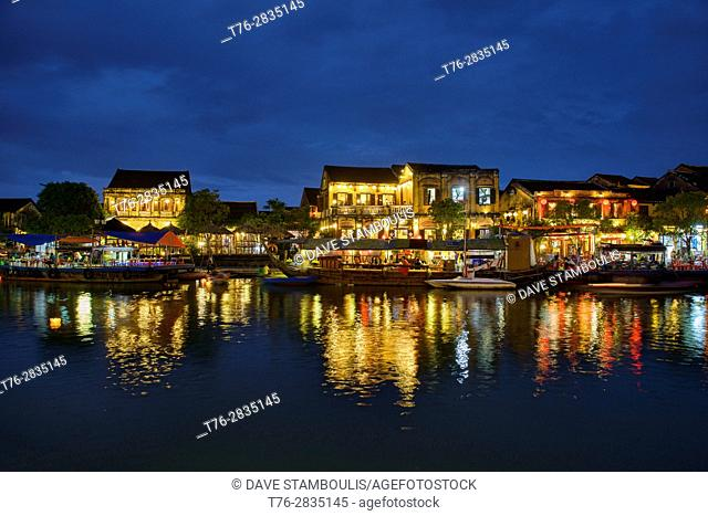 The old city by night across the Thu Bon River, Hoi An, Vietnam