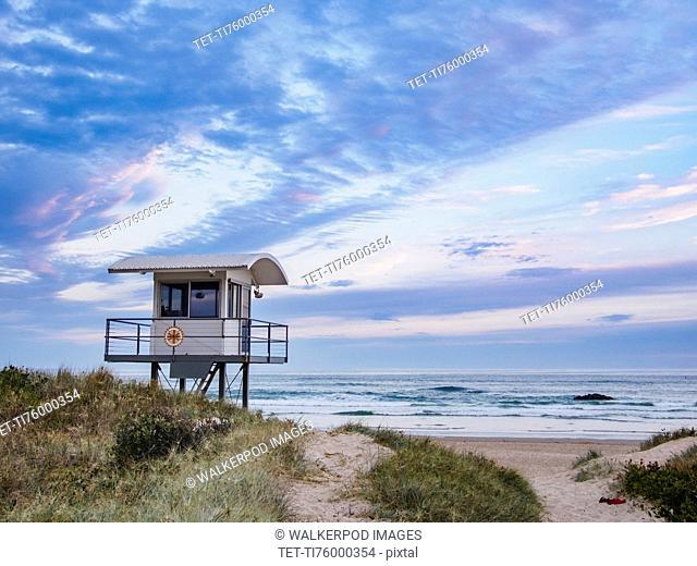 Australia, New South Wales, Lifeguard hut against moody sky
