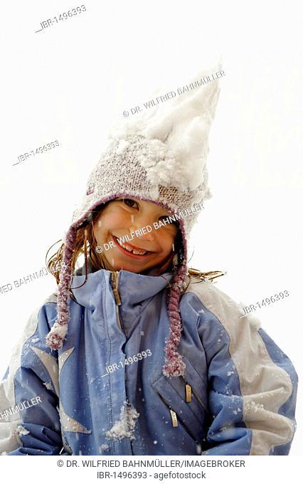 Girl playing in the snow, fun in winter