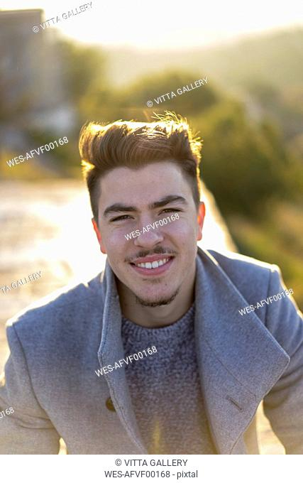 Portrait of smiling young man at sunset