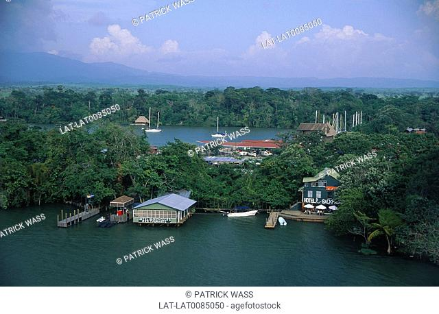 River town. Houses. backpackers hostel on thin strip of land. Thick woods