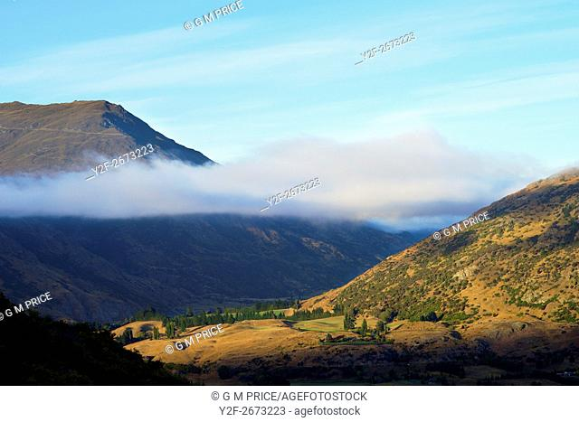 long cloud in mountain valley near Queenstown, New Zealand