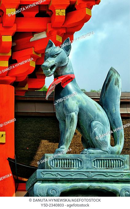 Statuette of Kitsune - Messenger-fox, entrance to Fushimi Inari-taisha Shrine, head shrine of Inari located in Fushimi-ku, Kyoto, Kansai Region, Japan