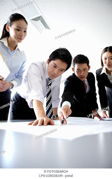Businesspeople Examining Blueprint