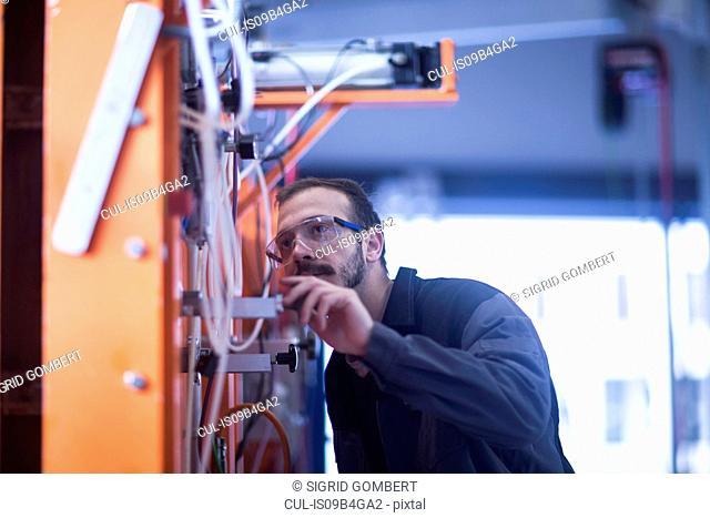 Engineer inspecting heavy machinery