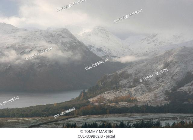 Low cloud and snow capped mountains at Ullswater, The Lake District, UK