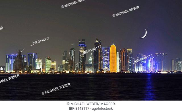 Night skyline of Doha with the Al Bidda Tower, Palm Tower 1 and 2, the World Trade Center, Tornado Tower, Burj Qatar Tower, golden illumination
