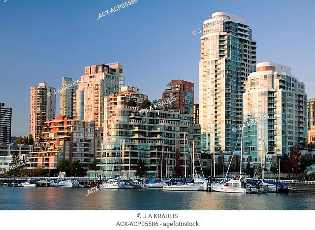 Boats docked in False Creek and downtown condominiums, Vancouver, British Columbia, Canada