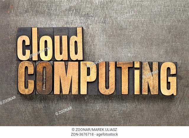 cloud computing - text in vintage letterpress wood type against a grunge metal sheet