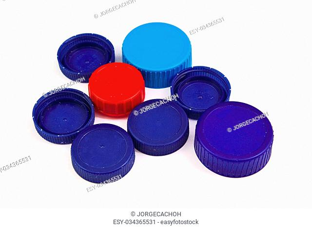 Composition with plastic caps isolated on a white background