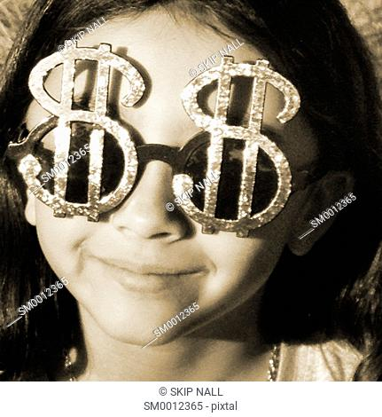 Young girl wearing sunglasses the look like dollar sign
