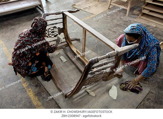 Women working in a furniture factory in Dhaka
