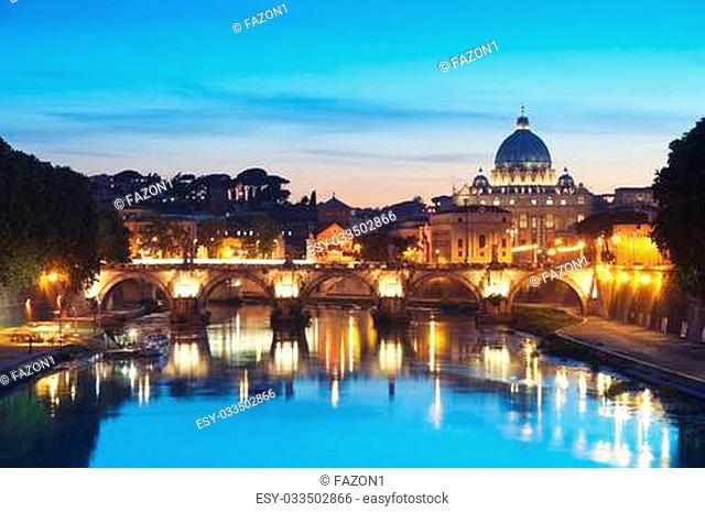 Night image of St. Peter's Basilica, Ponte Sant Angelo and Tiber River in Rome - Italy