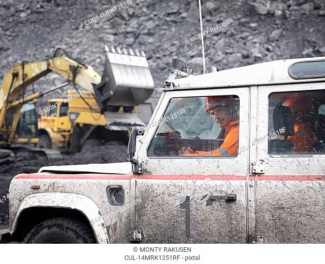 Coal Miners In Landrover In Mine