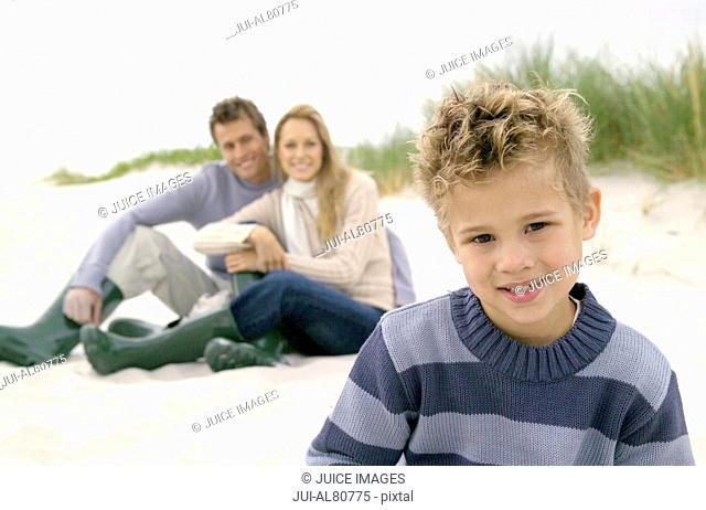 Family sitting in dunes at beach
