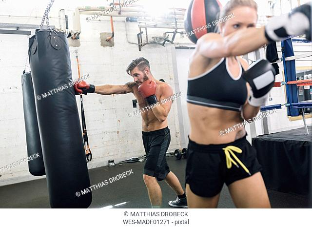 Two boxers exercising in boxing club