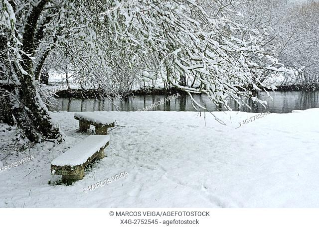 Lonely bench in a snow-covered, park