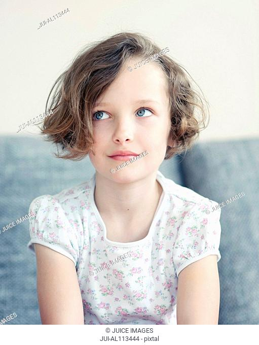 Young girl looking up