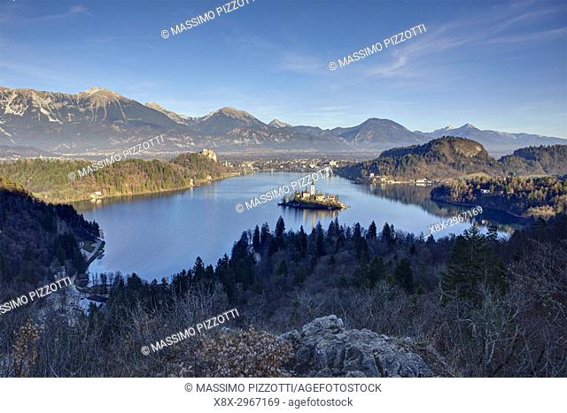 Elevated view of Lake Bled and the Church of Mary the Queen, located on a small island in the middle of the lake, Bled, Slovenia
