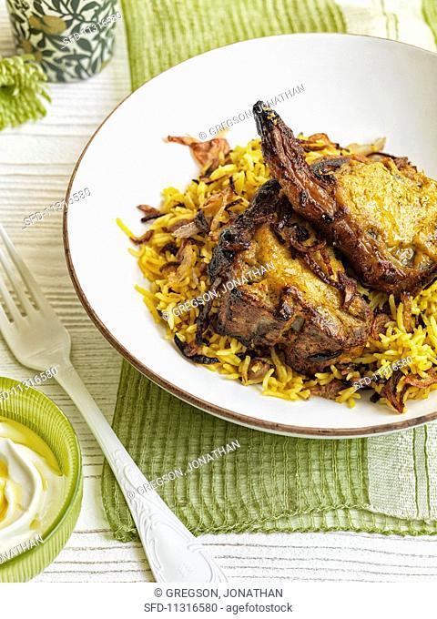 Spicy lamb chops with biryani rice (India)