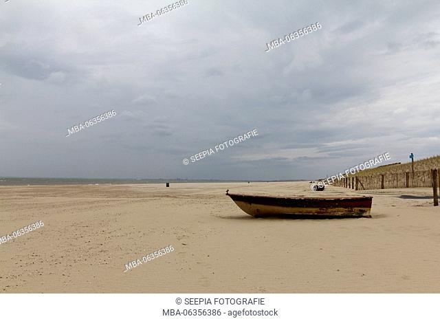 Boot on the beach in Cadzand, by the North Sea, deserted, peaceful which enjoy rest and the vacation