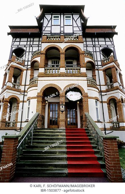 Mixed-style house, staircase with red carpet, hotel by the sea, Boltenhagen, Baltic Sea, Mecklenburg-Western Pomerania, Germany, Europe