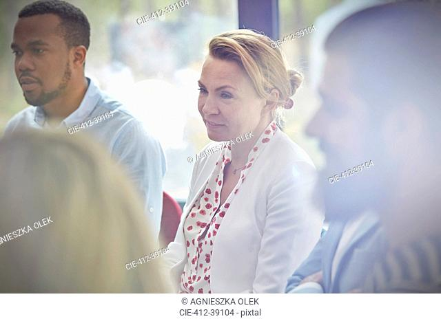 Woman listening in group therapy session