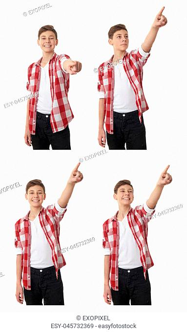 Cute teenager boy in red checkered shirt pointing forward over white isolated background, half body
