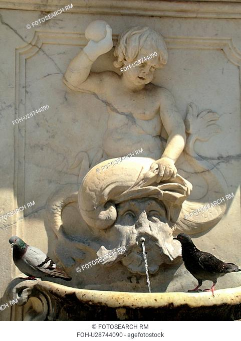 Pisa, Tuscany, Italy, Toscana, Europe, Pigeons roosting on a fountain in Campo dei Miracoli (Field of Miracles) in the city of Pisa