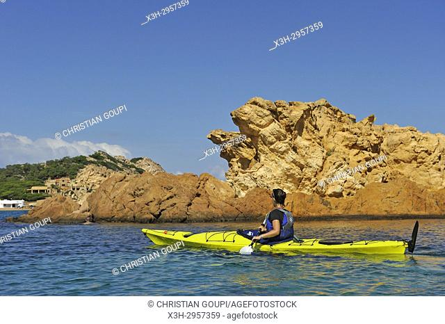 kayaker in the inlet Cala Pregonda near Cape Cavalleria on the North Coast of Menorca, Balearic Islands, Spain, Europe