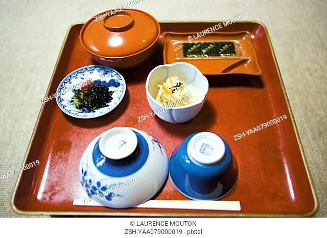 Japanese meal on tray with seaweed and cabbage