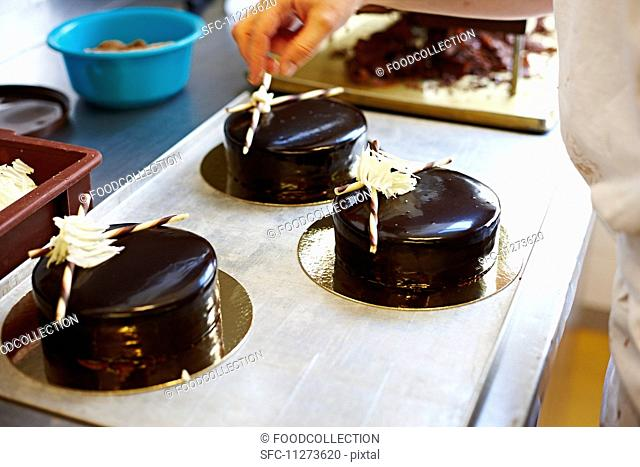 Festive cakes with a dark chocolate glaze