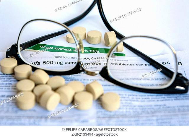 Glasses focus composition of medication, concept of prevention to read the small print of the prospectus pharmacist