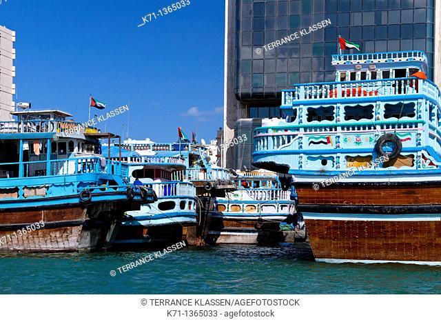 Elaborately decorated wooden dow boats in Dubai Creek, Dubai, UAE, Persian Gulf