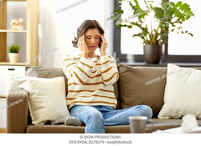 sad sick woman in scarf at home
