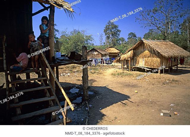 Children on a wooden house, Thailand