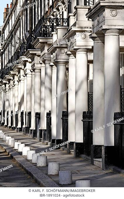 Row of houses with uniform classical column portals, Sussex Gardens, Paddington, London, England, United Kingdom, Europe