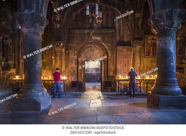 Armenia, Geghard, Geghard Monastery, Surp Astvatsatsin Church, 13th century, interior with visitors, NR