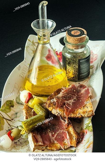 An appetezier snack, Iberic ham with olive oil and spices