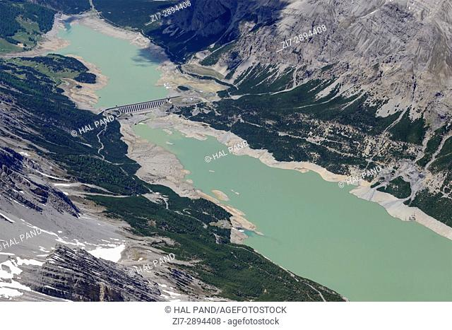aerial shot, from a small plane, of Cancano lake and its upper dam, shot on a bright summertime day in Bormio Alps , Italy