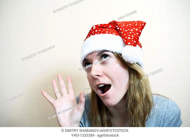 pretty girl in the Christmas hat grimasing