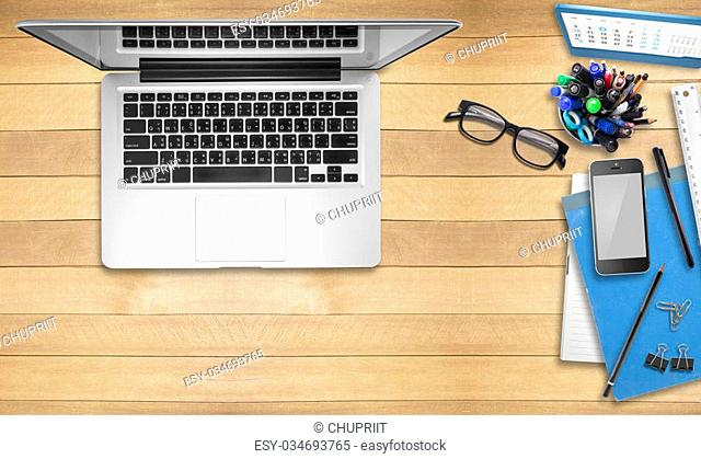 Top view Set of laptop, note, pen, book, spectacle on a wooden table background