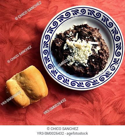 A piece of bread and black beans in Santa Clara restaurant in Puebla, Mexico