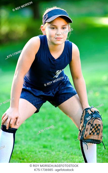 Young softball player ready to catch ball